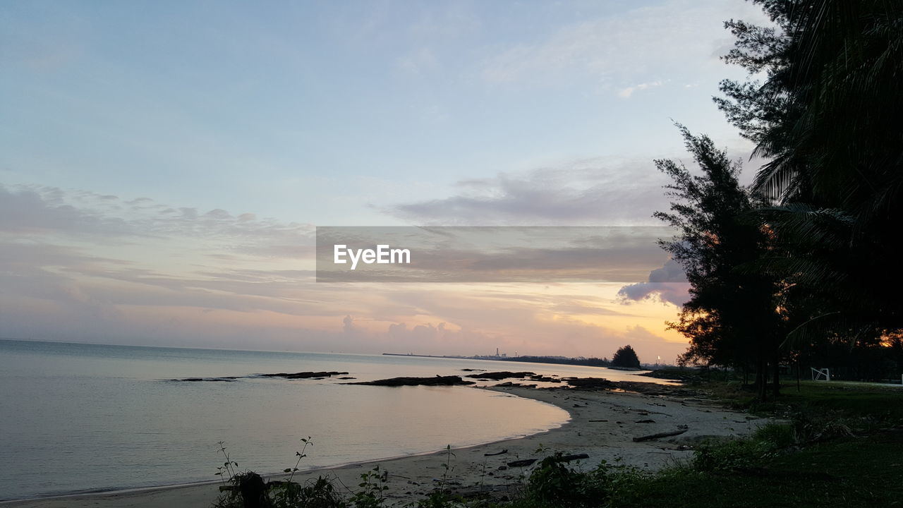 sunset, sky, water, nature, sea, tranquility, tranquil scene, scenics, beauty in nature, beach, no people, landscape, outdoors, tree, day