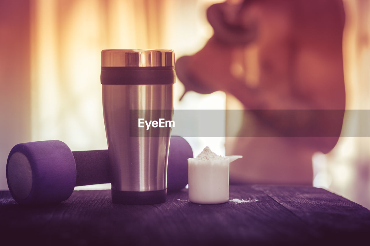 drink, food and drink, table, refreshment, one person, indoors, focus on foreground, freshness, adult, real people, lifestyles, cup, glass, coffee, women, coffee - drink, close-up, leisure activity, selective focus, purple