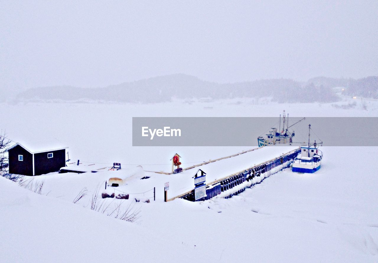 View Of Jetty On Frozen Lake