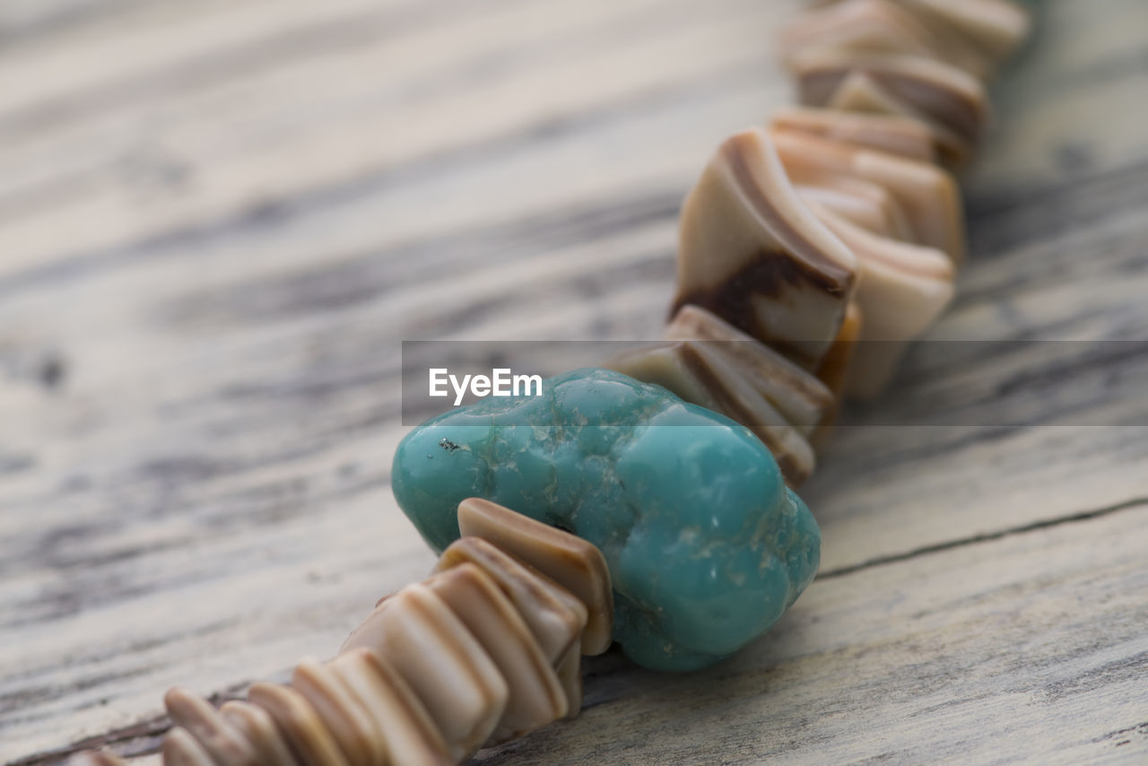 High angle view of stone bracelet on table