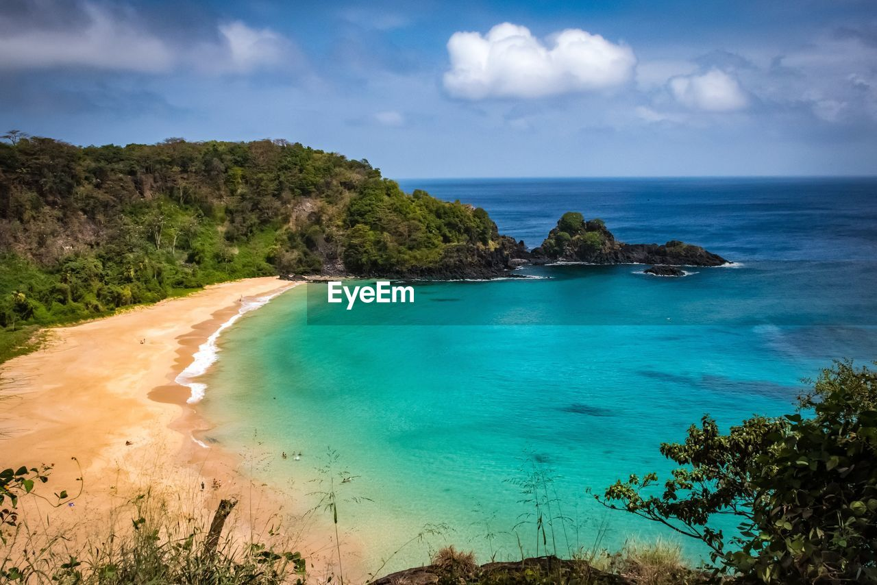 sky, sea, water, scenics - nature, beauty in nature, land, cloud - sky, tranquil scene, plant, tranquility, horizon, horizon over water, tree, beach, nature, blue, day, no people, idyllic, turquoise colored, outdoors
