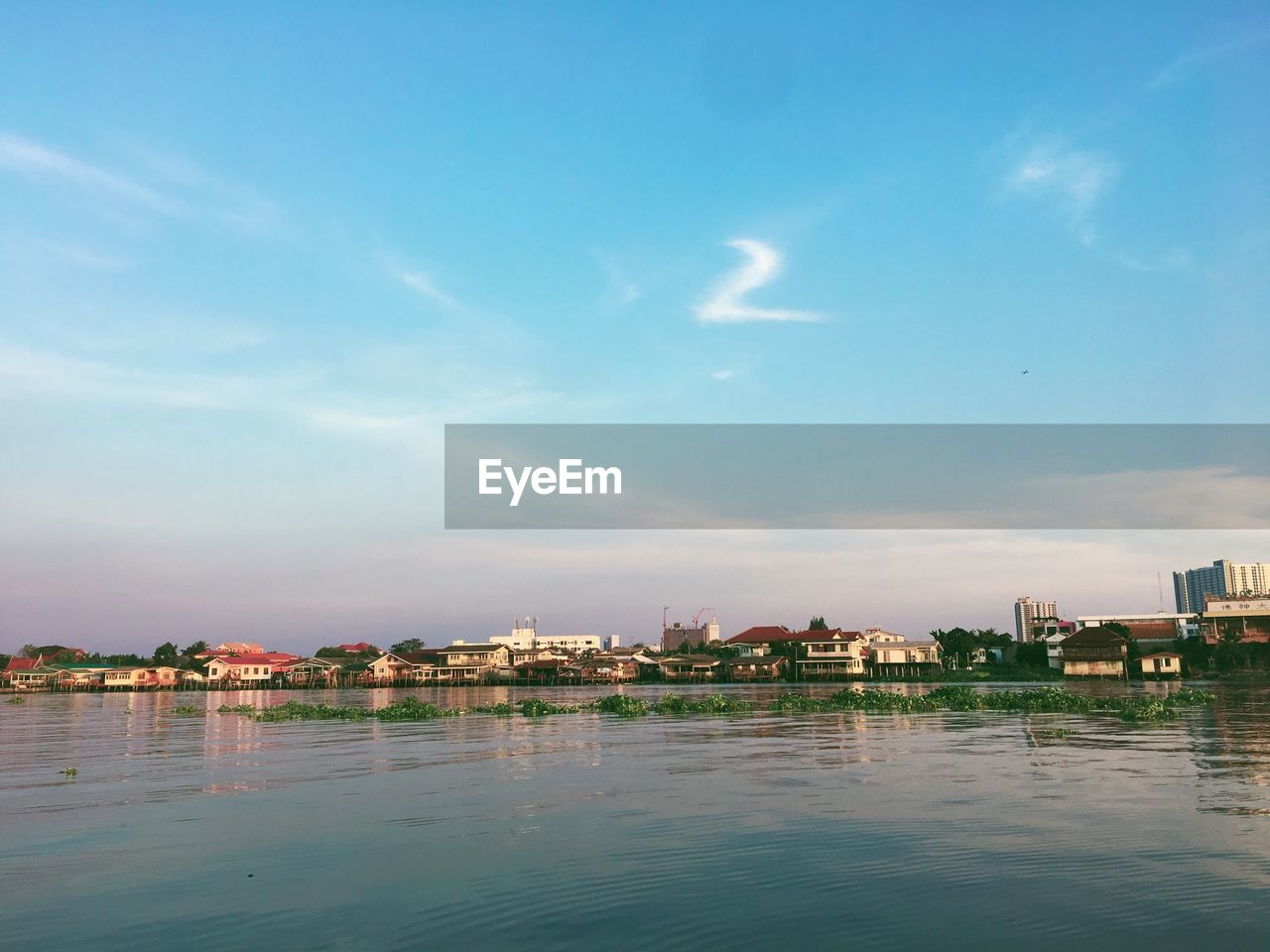 water, building exterior, architecture, sky, built structure, cloud - sky, waterfront, building, no people, nature, city, sea, outdoors, day, residential district, blue, house, scenics - nature