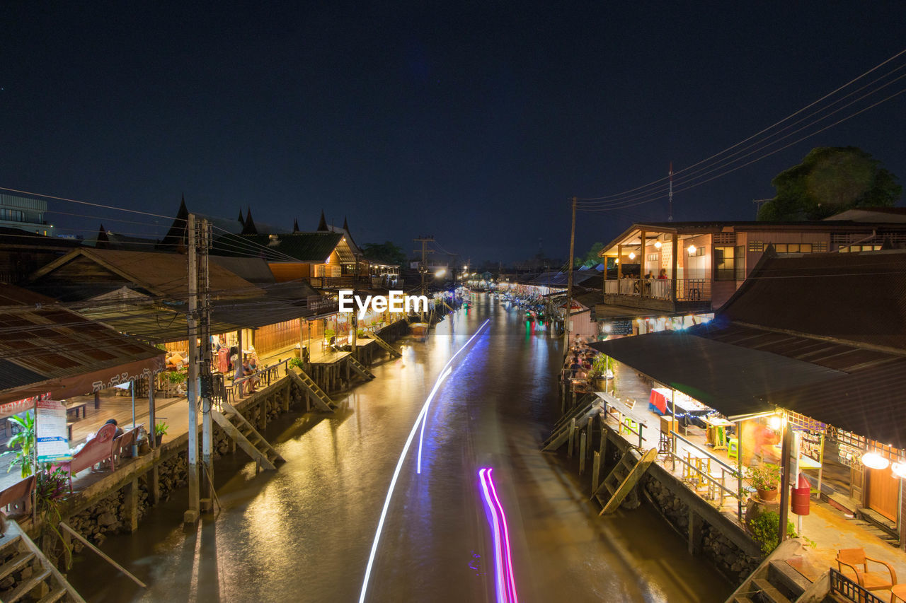 illuminated, night, architecture, built structure, transportation, building exterior, water, city, motion, bridge, road, sky, street, bridge - man made structure, nature, long exposure, connection, mode of transportation, blurred motion, canal, no people, outdoors, light