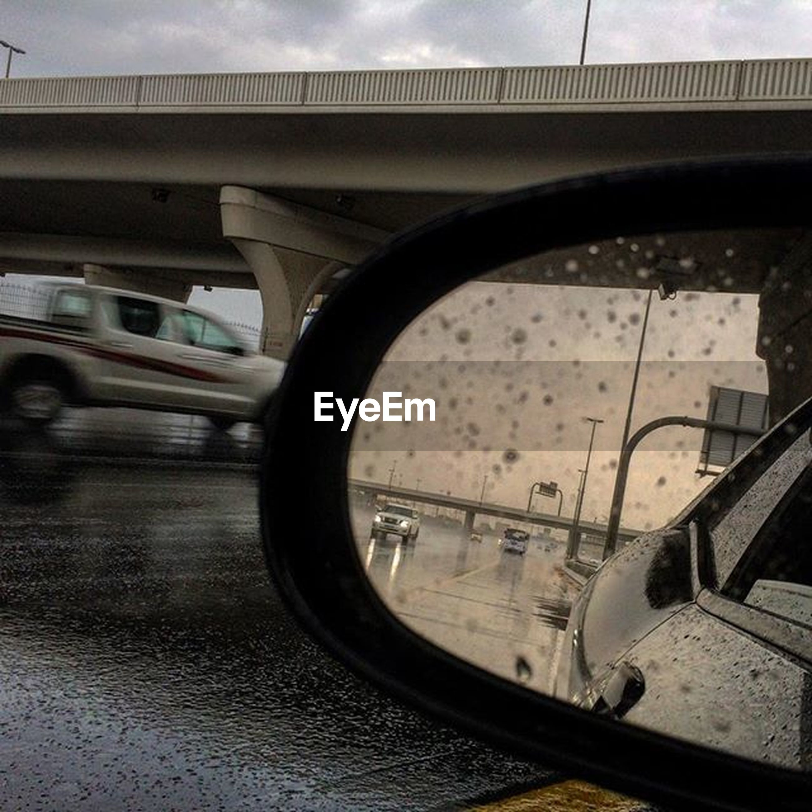transportation, mode of transport, land vehicle, car, reflection, water, side-view mirror, part of, vehicle interior, close-up, glass - material, wet, cropped, road, sky, travel, street, transparent, season, vehicle part