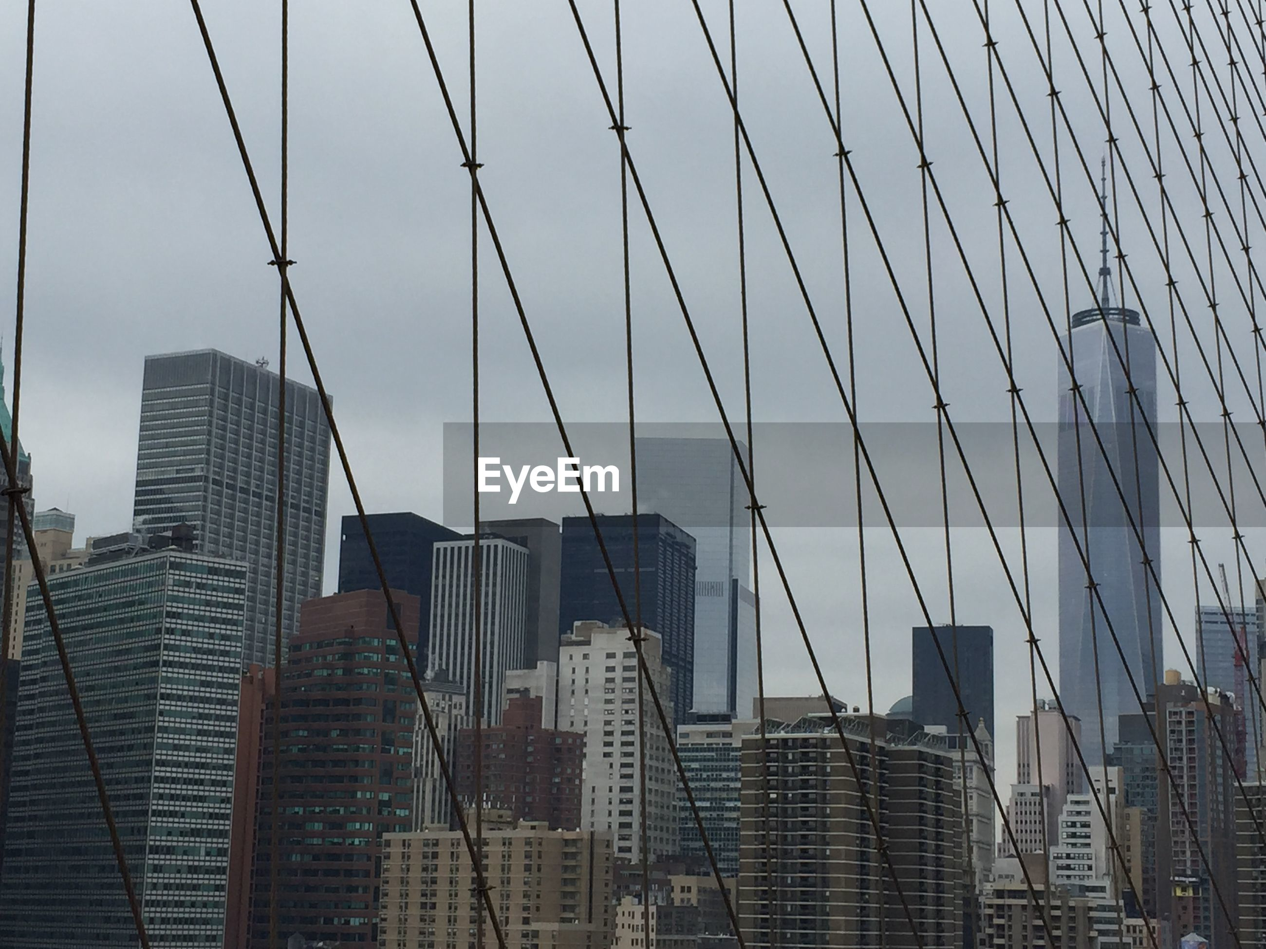 Cityscape seen through steel cables