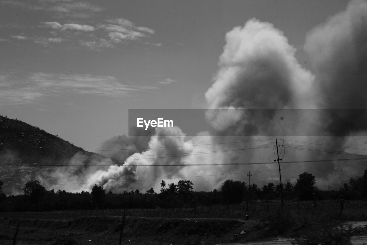 smoke - physical structure, air pollution, sky, pollution, no people, emitting, smoke stack, nature, factory, cloud - sky, landscape, scenics, day, tranquility, tree, outdoors, beauty in nature, industry, electricity pylon, vapor trail