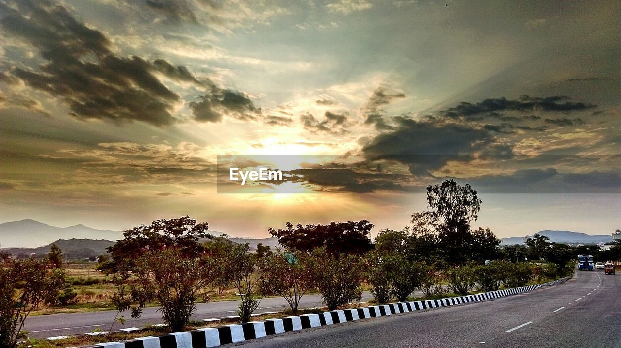 sky, cloud - sky, tree, road, sunset, scenics, nature, beauty in nature, no people, tranquility, tranquil scene, sun, the way forward, outdoors, transportation, day