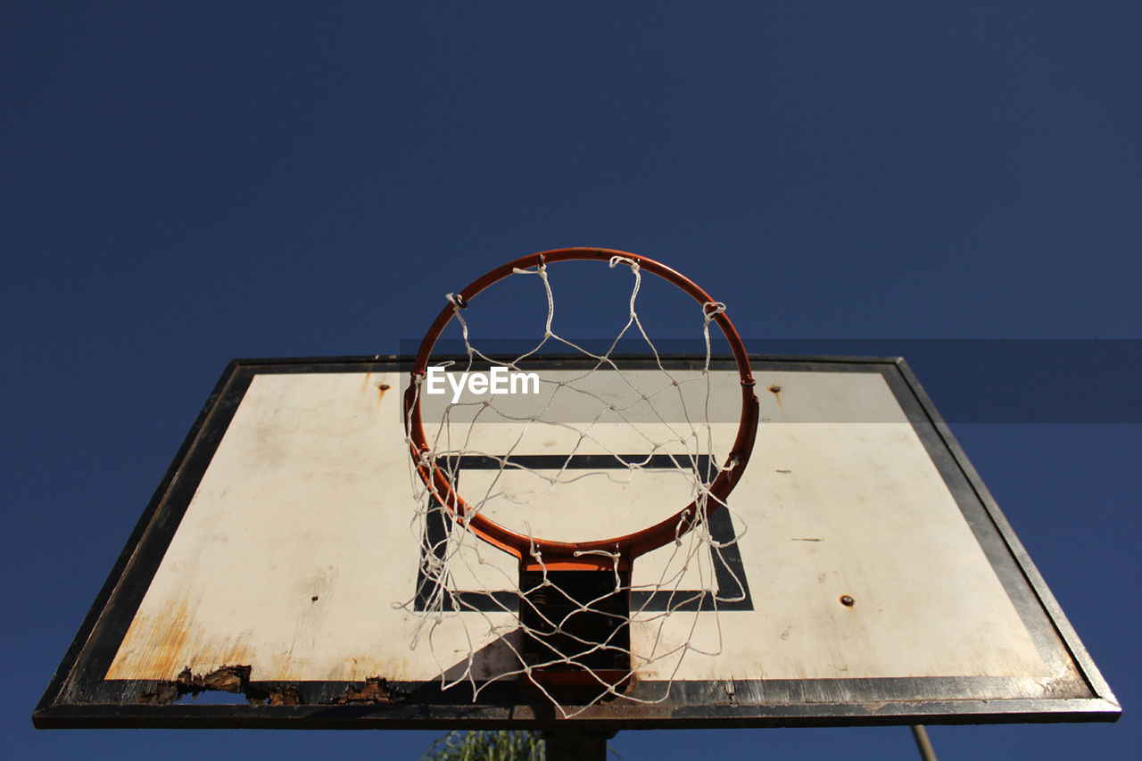 basketball - sport, sport, basketball hoop, basketball, copy space, low angle view, clear sky, net - sports equipment, leisure games, blue, court, outdoors, day, no people, close-up, sky