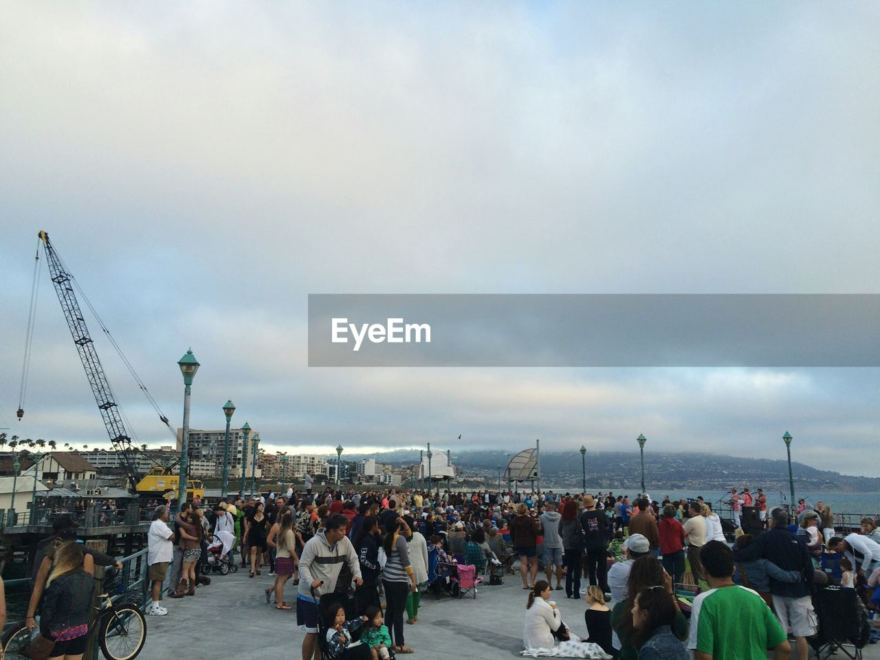 real people, large group of people, cloud - sky, sky, men, women, lifestyles, built structure, day, transportation, leisure activity, outdoors, sea, city, architecture, water, crowd, nature, building exterior, cityscape, adult, people