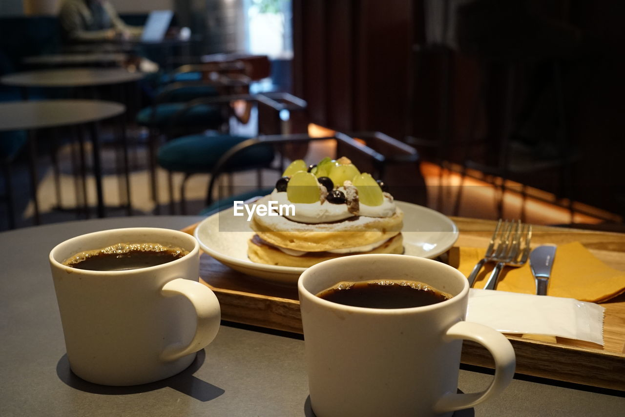 food and drink, cup, table, freshness, coffee cup, mug, drink, refreshment, coffee, coffee - drink, focus on foreground, food, ready-to-eat, still life, sweet, sweet food, indoors, close-up, no people, dessert, hot drink, crockery, temptation, tea cup, non-alcoholic beverage