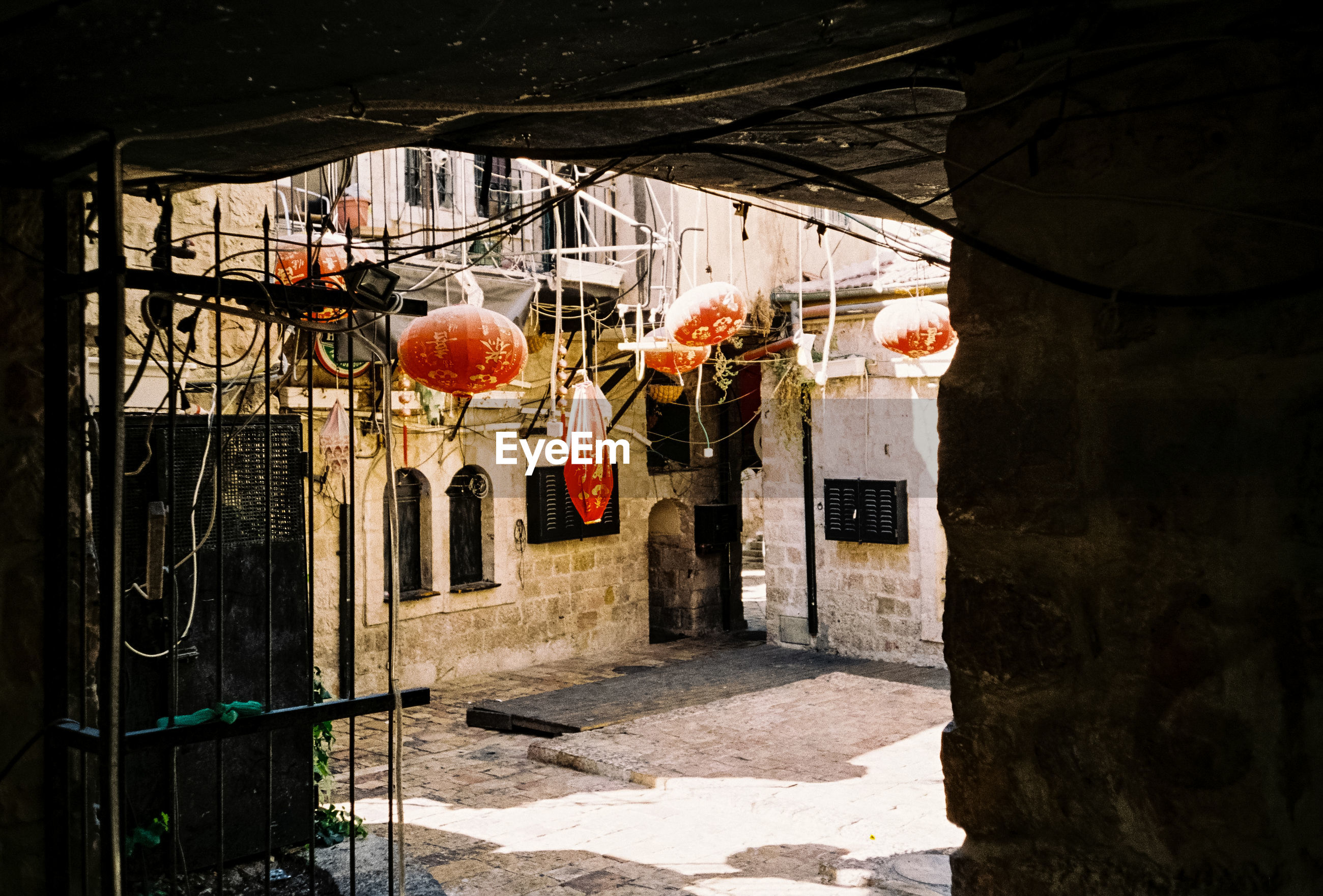 Lanterns hanging by building on sunny day
