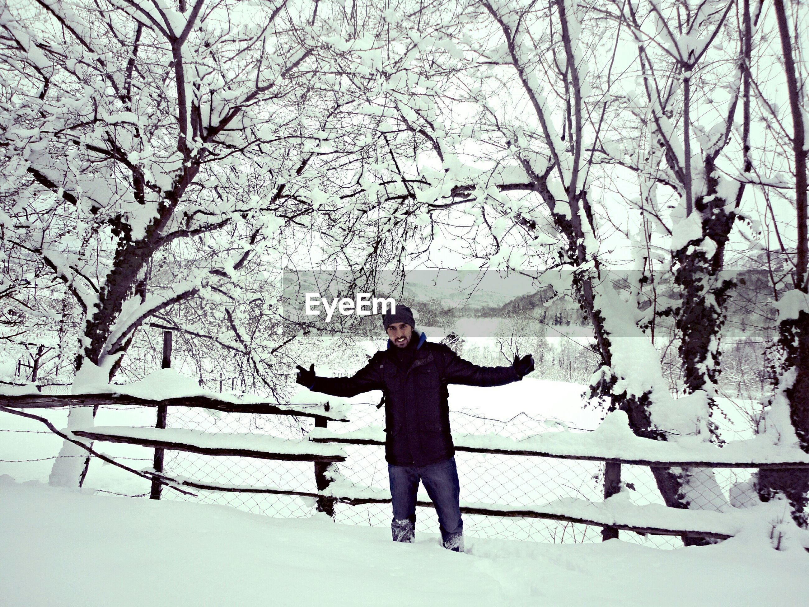 winter, snow, lifestyles, cold temperature, bare tree, season, full length, leisure activity, tree, standing, weather, warm clothing, branch, young women, young adult, casual clothing, day, front view