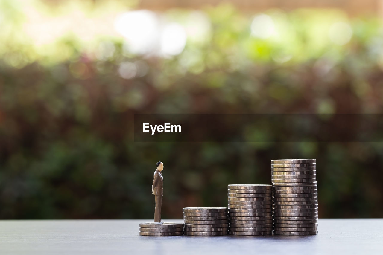 finance, coin, stack, currency, business, savings, table, growth, wealth, investment, focus on foreground, finance and economy, no people, nature, metal, development, still life, large group of objects, graph, diagram, outdoors, silver colored, making money, economy, luxury