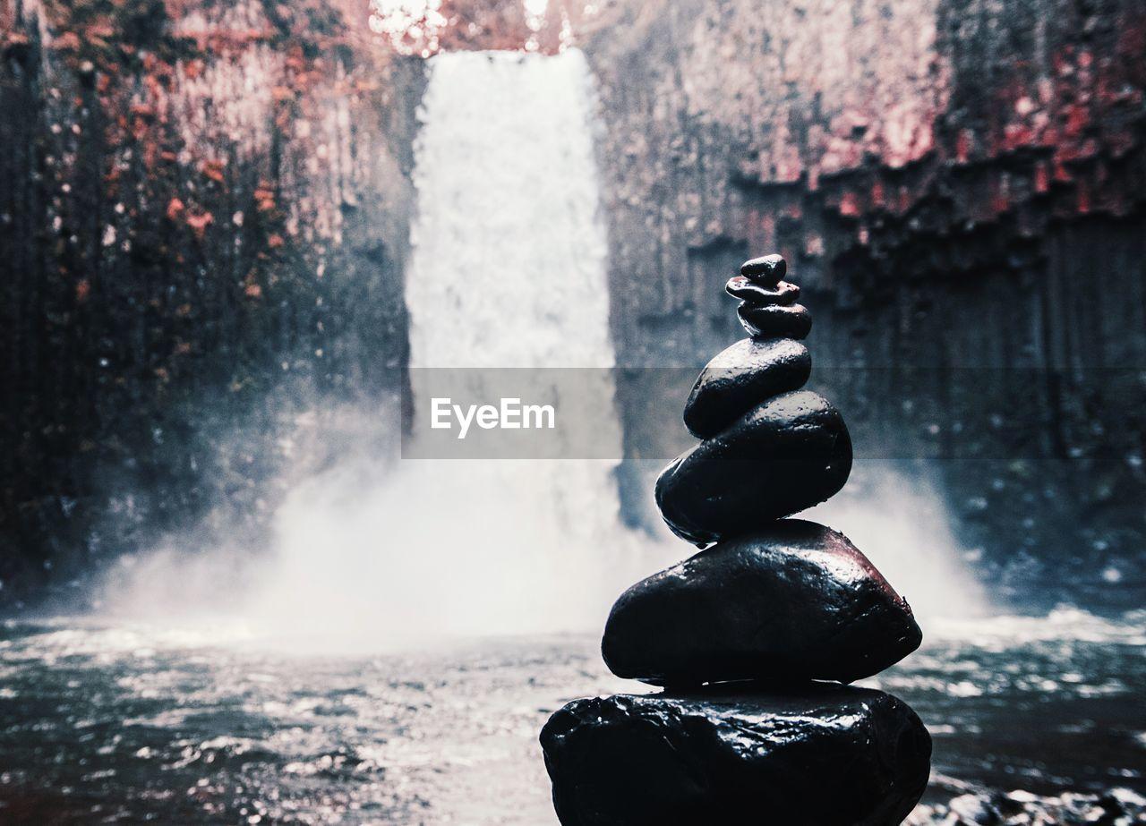 Fountain Against Waterfall