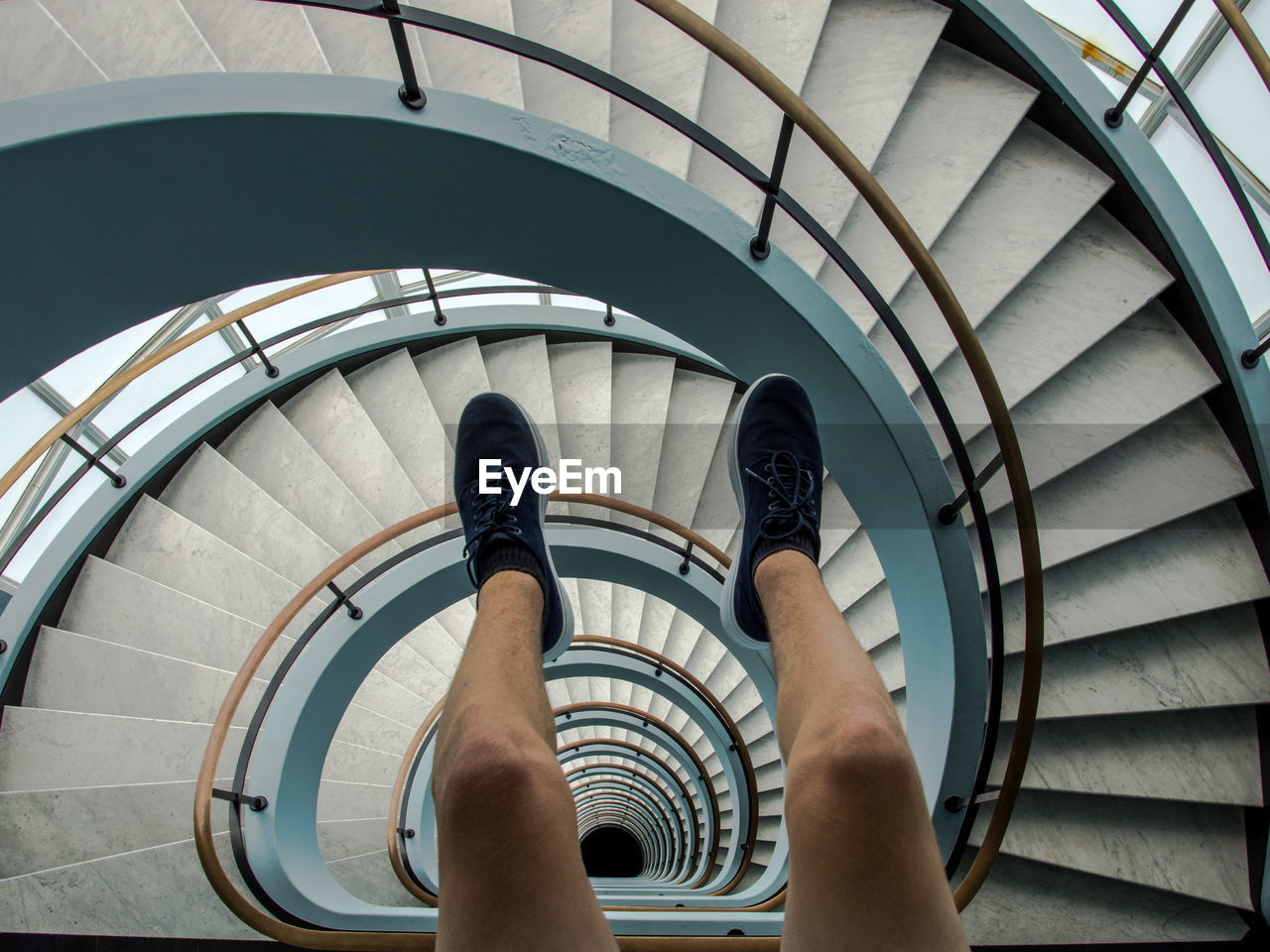 Low Section Of Man On Spiral Staircase
