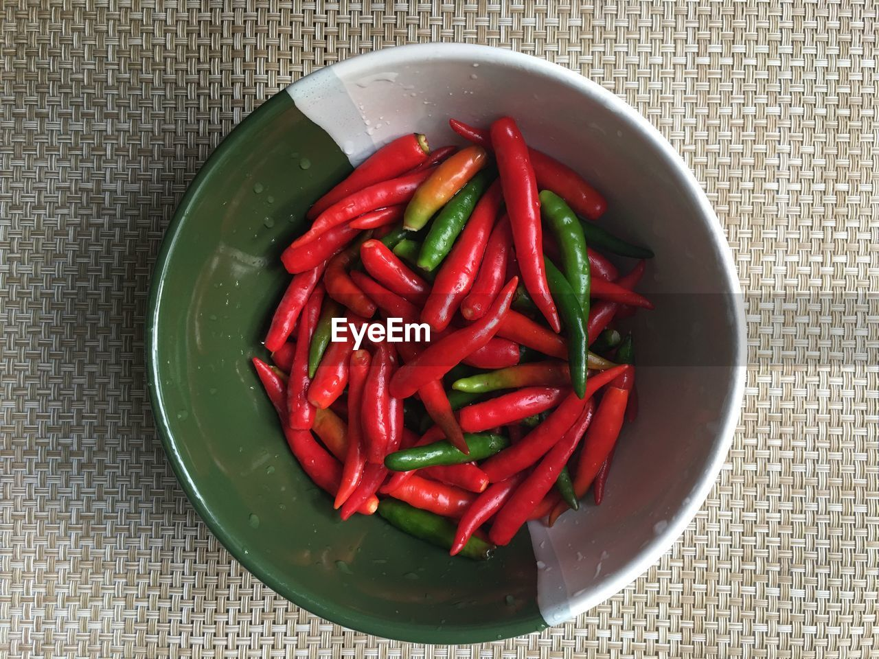 food and drink, vegetable, food, pepper, chili pepper, red, wellbeing, healthy eating, freshness, indoors, spice, still life, red chili pepper, bowl, table, directly above, high angle view, close-up, no people, green color