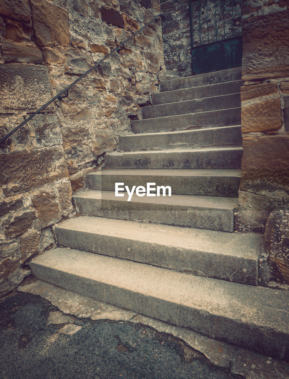 staircase, steps and staircases, architecture, no people, built structure, stone wall, the way forward, solid, stone material, direction, moving up, old, wall, wall - building feature, day, railing, absence, pattern, indoors