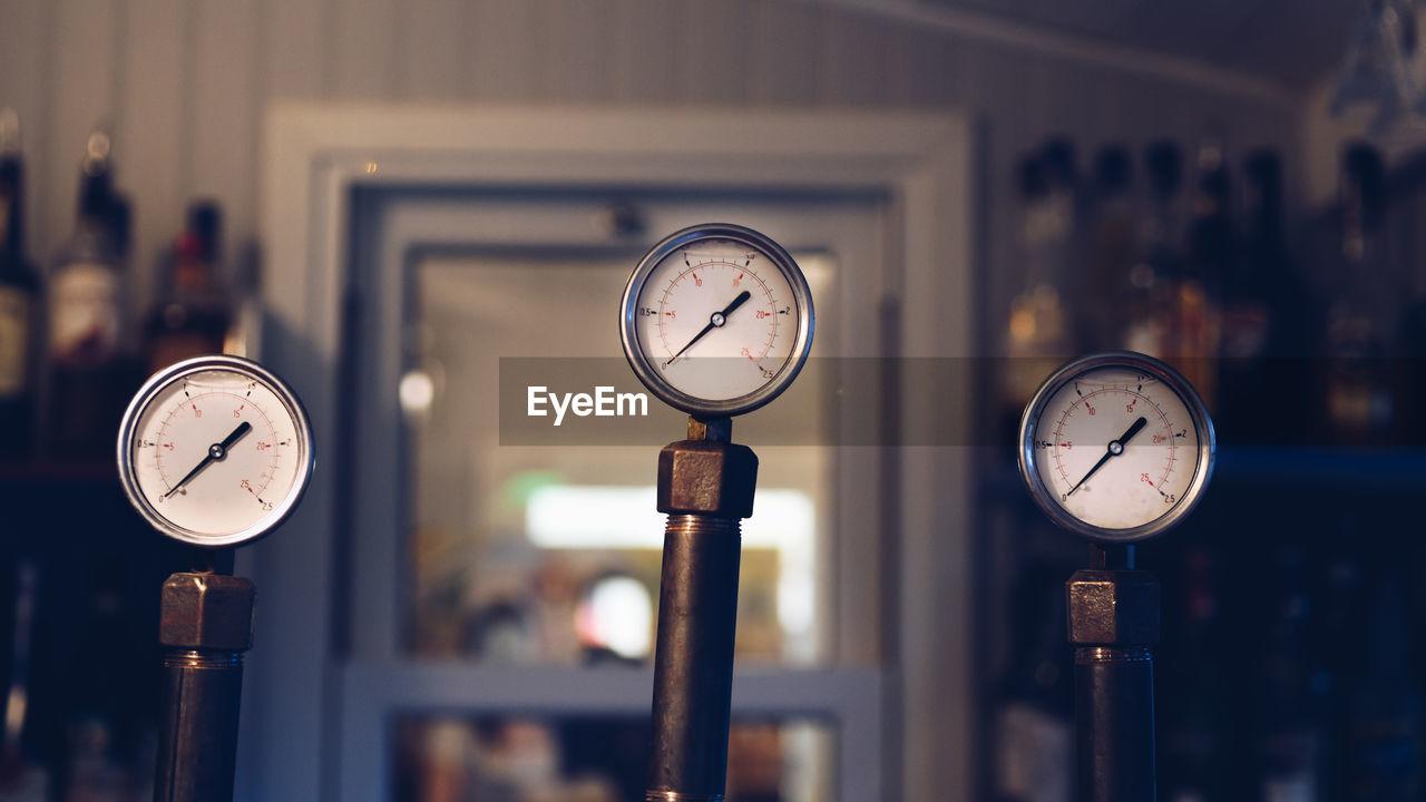 Close-up of pressure gauges in workshop