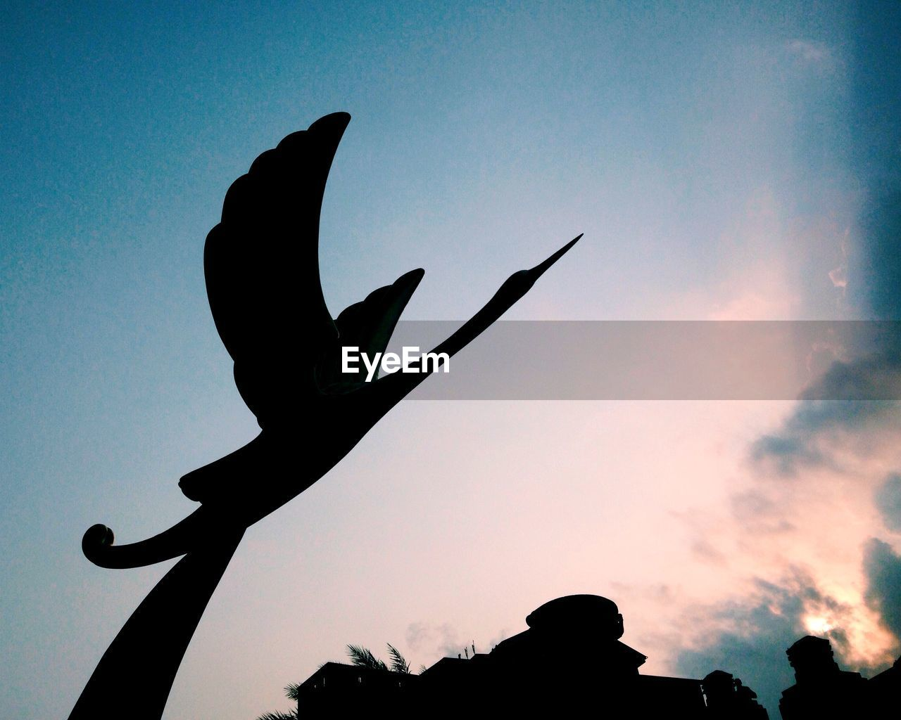 silhouette, low angle view, sky, sunset, outdoors, no people, sculpture, nature, day, clear sky, close-up, bird