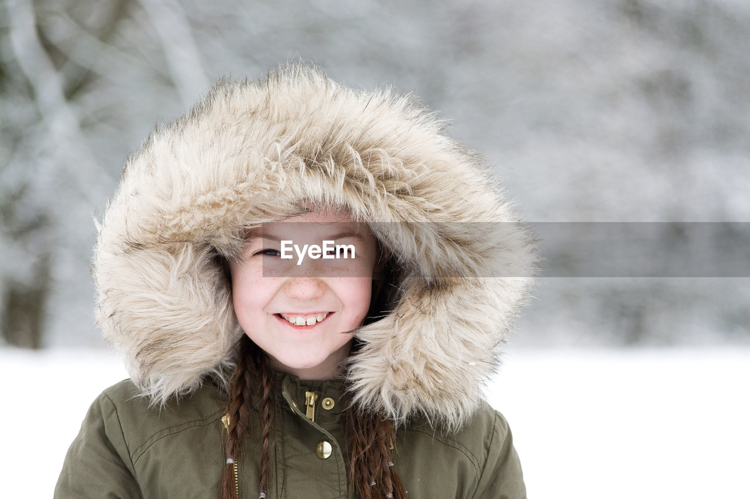 portrait, person, looking at camera, smiling, front view, winter, lifestyles, young adult, headshot, cold temperature, happiness, snow, focus on foreground, leisure activity, warm clothing, young women, toothy smile, season