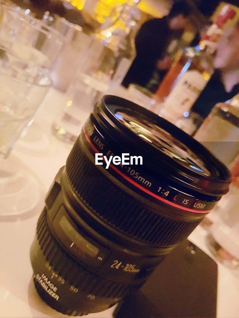 focus on foreground, close-up, indoors, food and drink, still life, text, bottle, refreshment, food, incidental people, container, drink, table, arts culture and entertainment, high angle view, photography themes, western script, business, alcohol