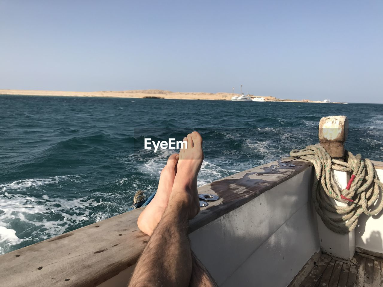 water, sea, sky, body part, low section, barefoot, human leg, human body part, one person, clear sky, nature, leisure activity, real people, personal perspective, horizon, horizon over water, lifestyles, relaxation, beauty in nature, human foot, outdoors, human limb