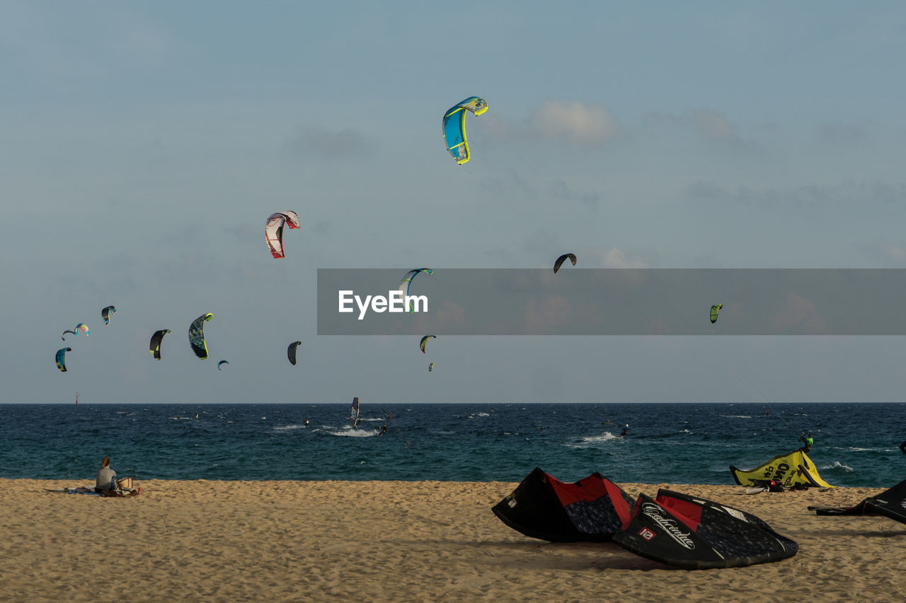 sea, real people, beach, leisure activity, horizon over water, extreme sports, kiteboarding, nature, parachute, water, lifestyles, mid-air, sport, day, sky, adventure, outdoors, scenics, beauty in nature, sand, flying, vacations, men, paragliding, one person