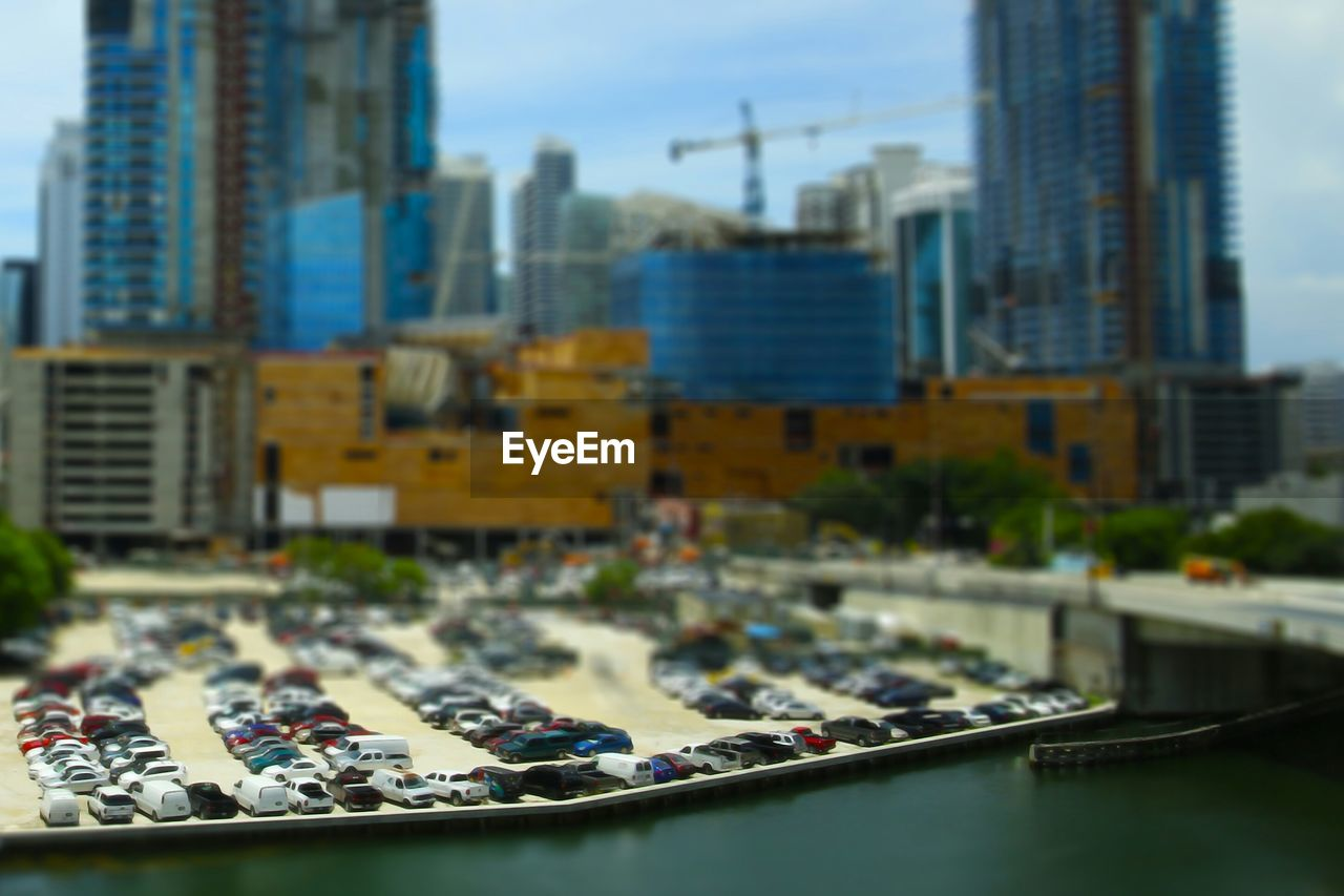 architecture, building exterior, city, transportation, built structure, skyscraper, day, outdoors, cityscape, car, water, travel destinations, no people, modern, tilt-shift, nautical vessel, close-up, sky