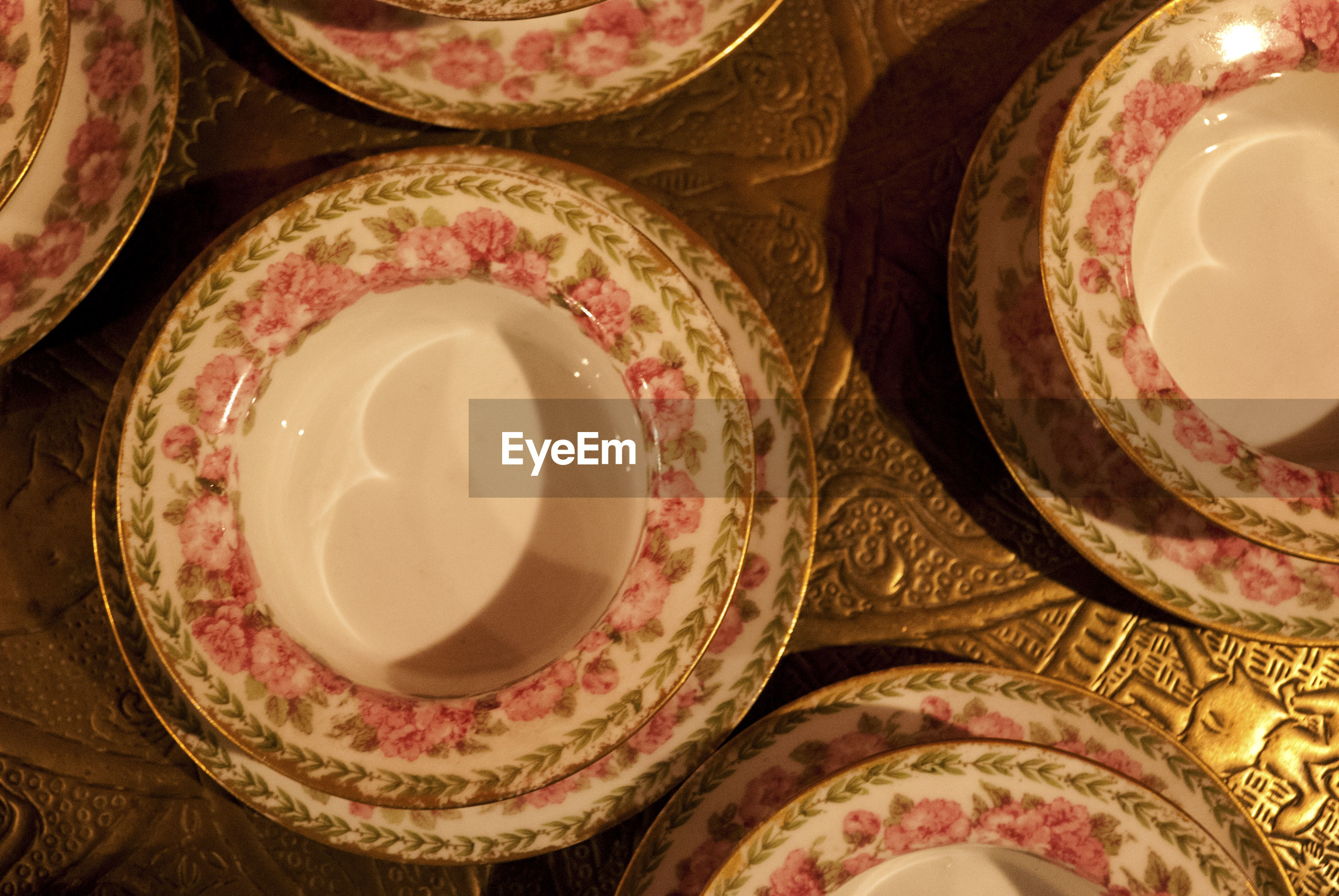 Close-up of porcelain plates on table