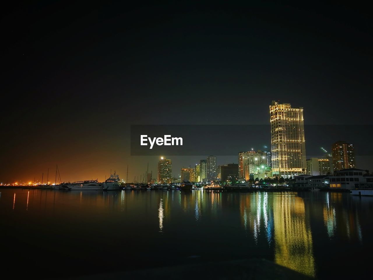 illuminated, night, architecture, building exterior, skyscraper, built structure, cityscape, reflection, tower, city, urban skyline, travel destinations, sky, waterfront, river, water, no people, modern, outdoors, nature