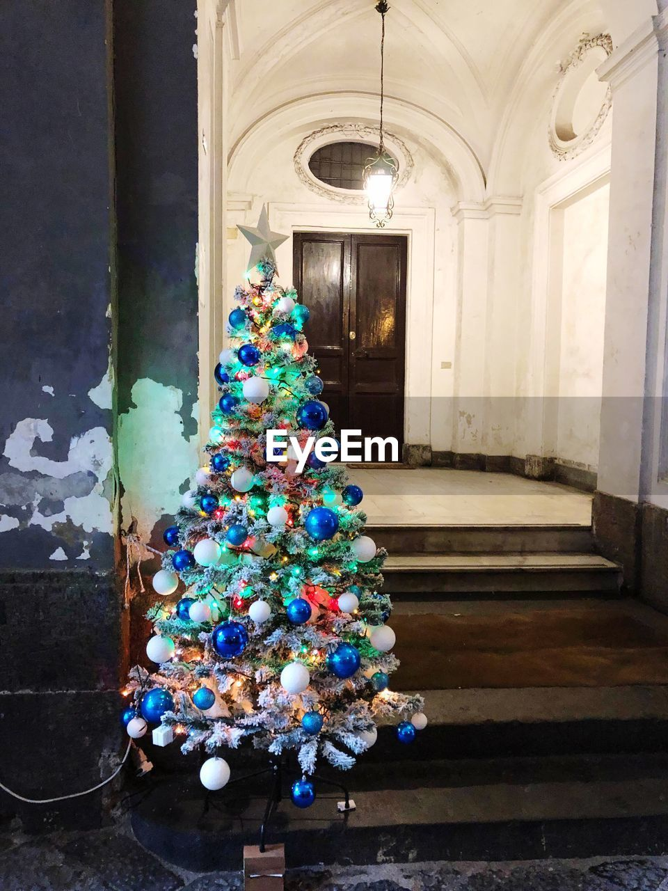 building, no people, decoration, celebration, christmas, architecture, indoors, holiday, christmas tree, multi colored, christmas decoration, built structure, religion, stack, arch, illuminated, day, belief, christmas ornament