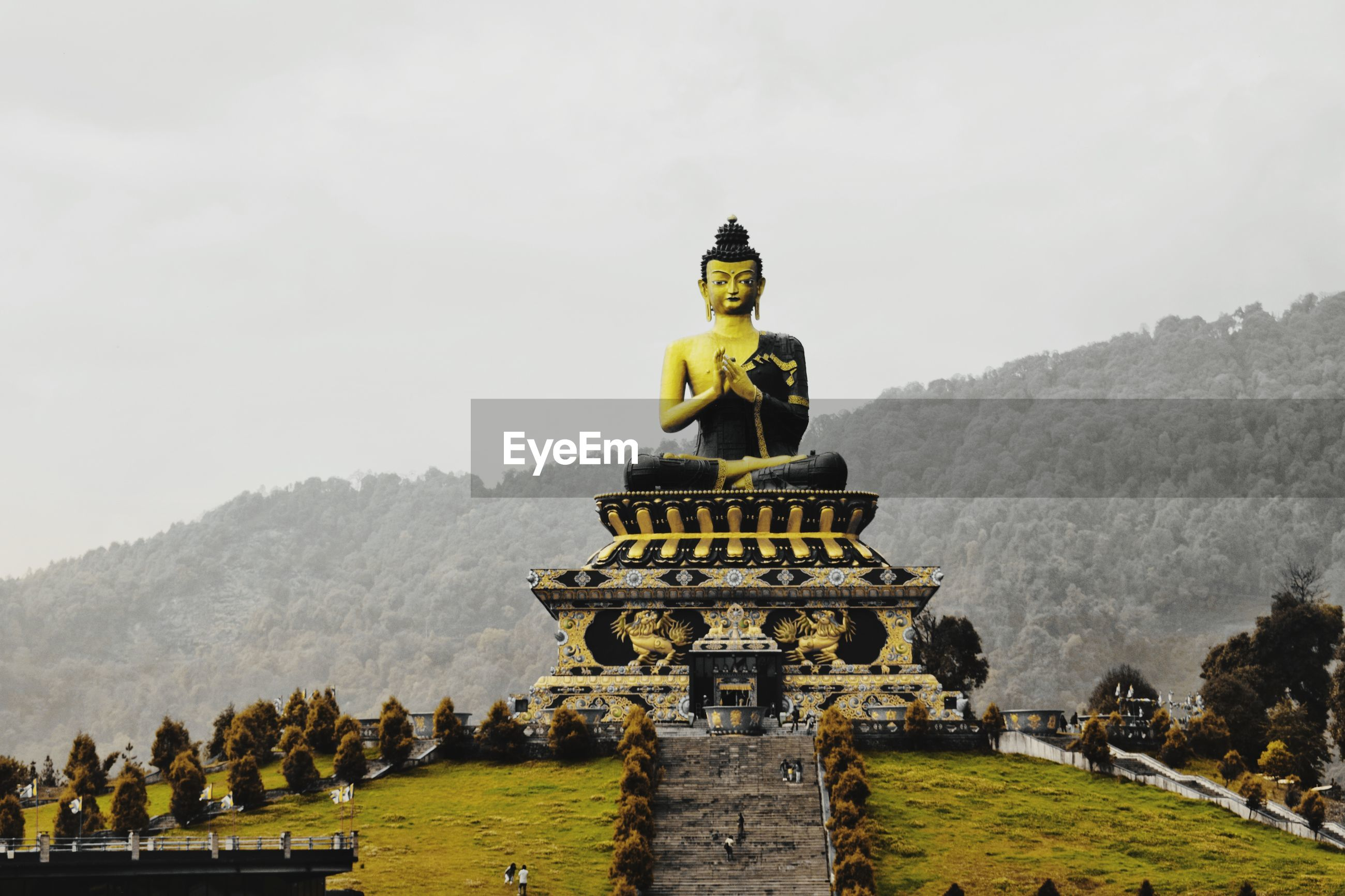 Statue in temple against sky