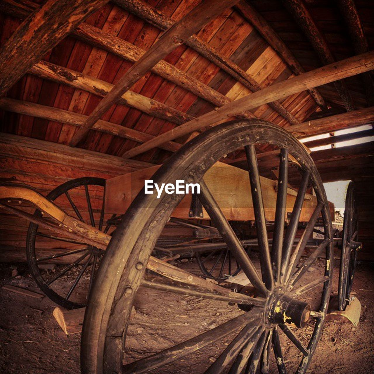 wood - material, old-fashioned, wheel, wagon wheel, old, obsolete, antique, rusty, no people, abandoned, mode of transport, spoke, transportation, day, rustic, indoors
