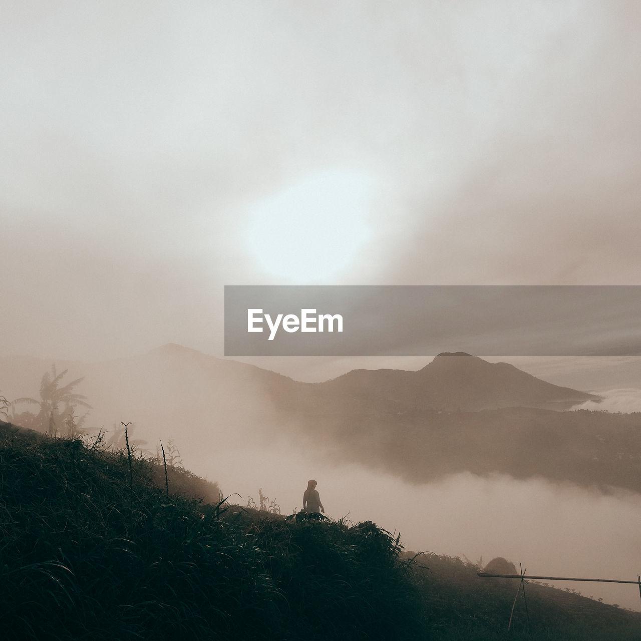 SCENIC VIEW OF FOG AGAINST SKY