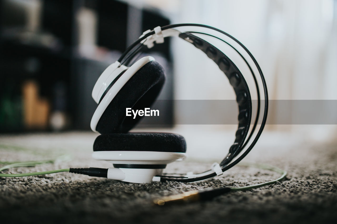 Close-up of headphones on carpet at home