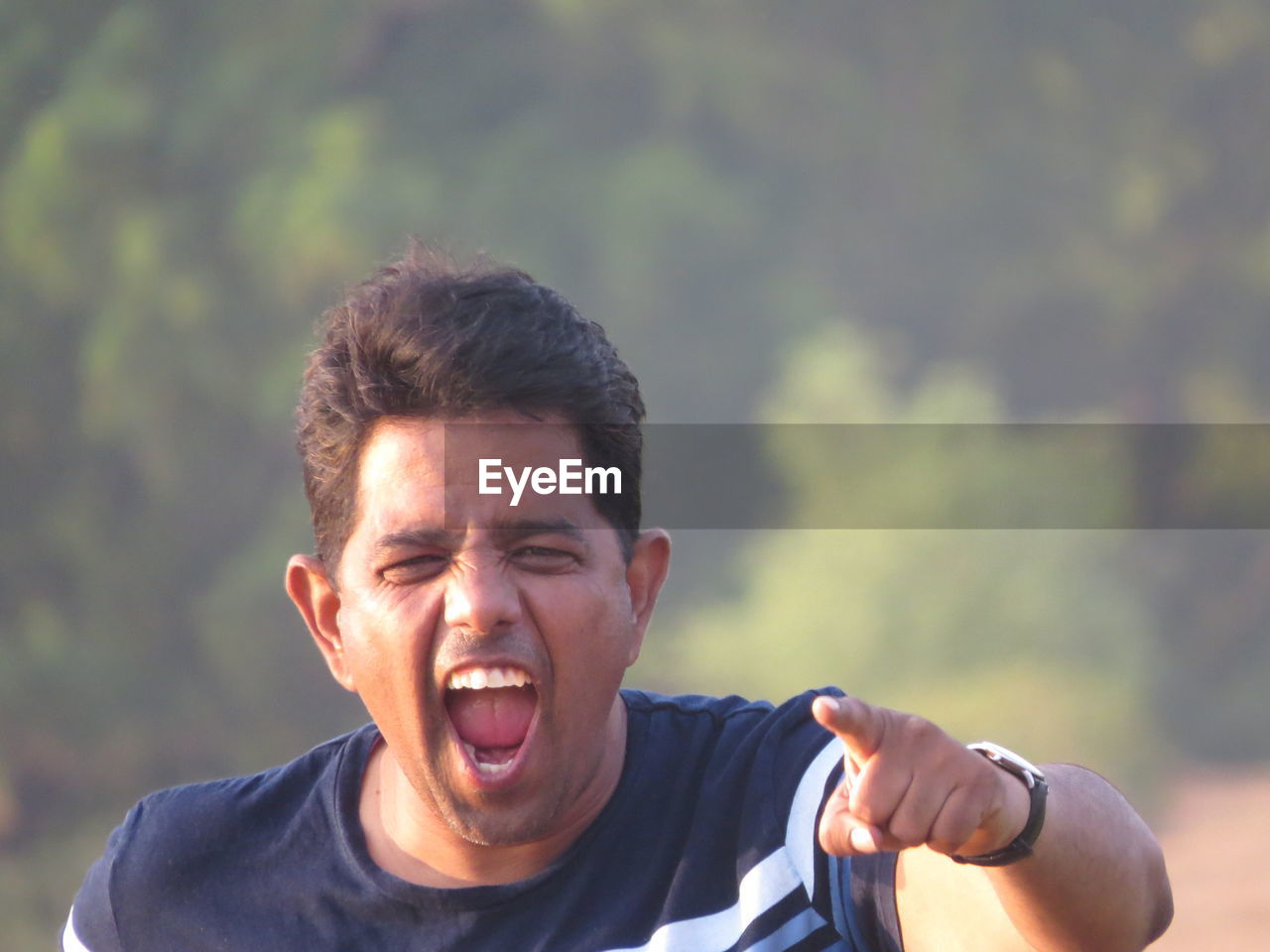 Portrait of young man screaming outdoors
