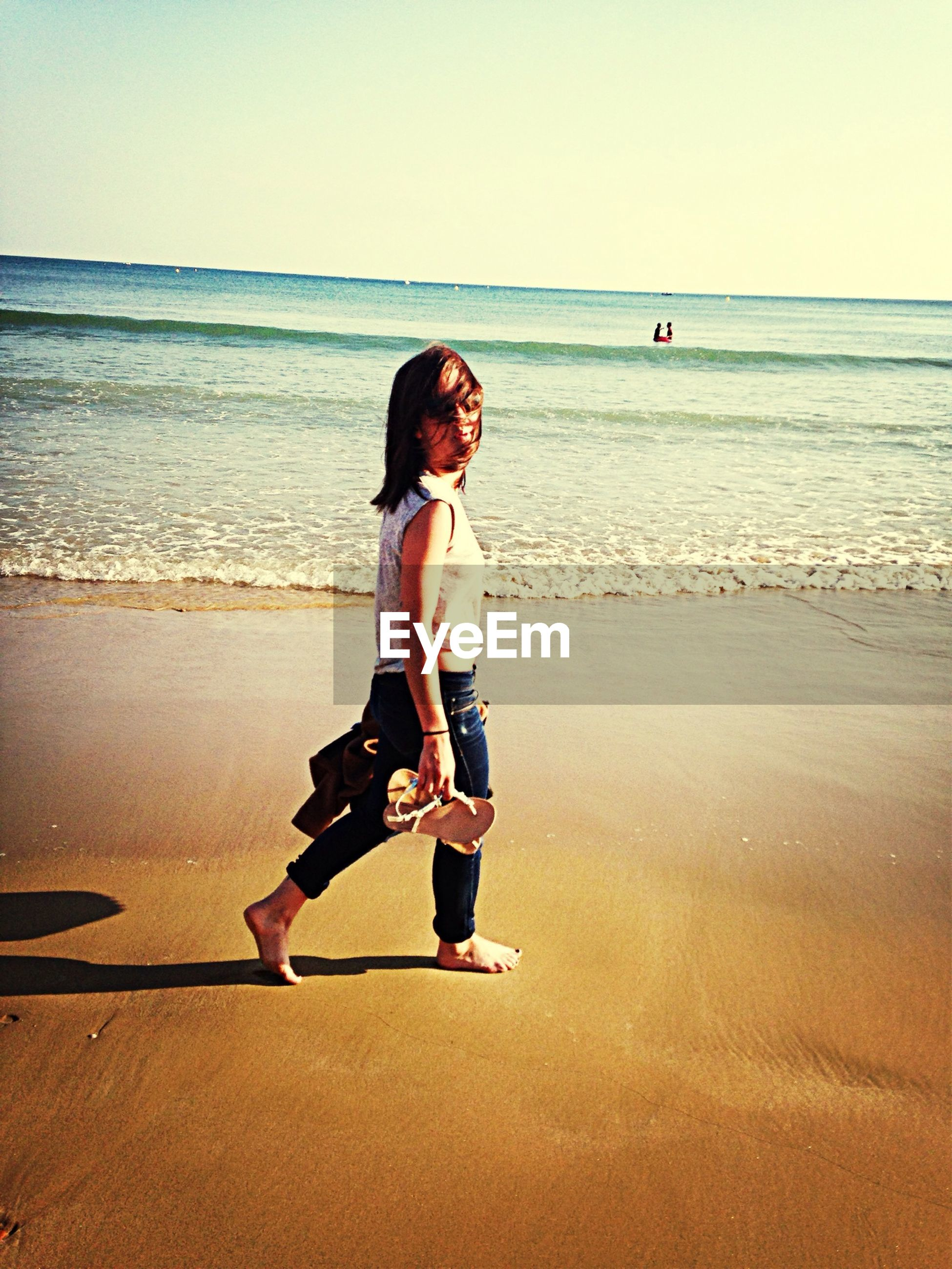 sea, beach, horizon over water, water, shore, sand, clear sky, full length, leisure activity, lifestyles, vacations, casual clothing, tranquility, tranquil scene, beauty in nature, rear view, standing, scenics