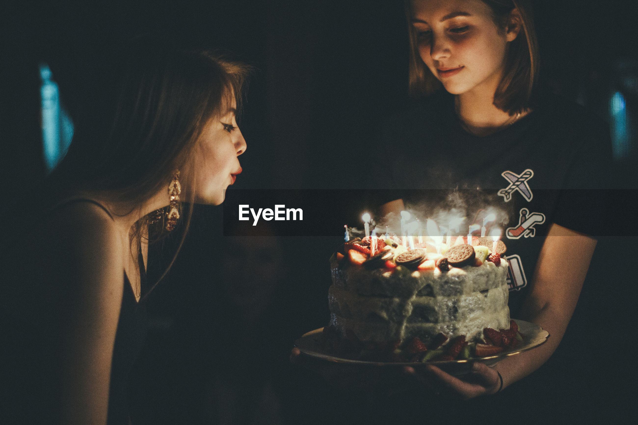 Birthday cake in dark room