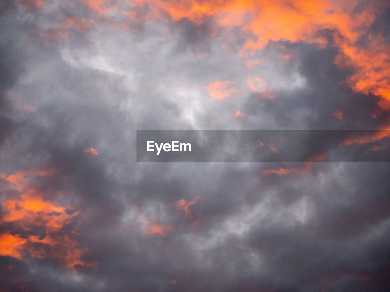 cloud - sky, sky, beauty in nature, low angle view, orange color, nature, scenics - nature, no people, tranquility, sunset, backgrounds, outdoors, tranquil scene, full frame, dramatic sky, idyllic, overcast, cloudscape, storm, meteorology