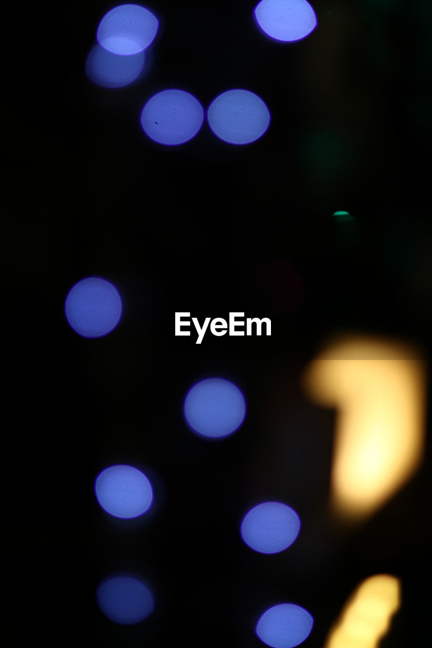 illuminated, lighting equipment, night, defocused, glowing, light effect, abstract, no people, backgrounds, multi colored, fairy lights, close-up, pattern, electricity, black background, outdoors, disco lights, projection equipment