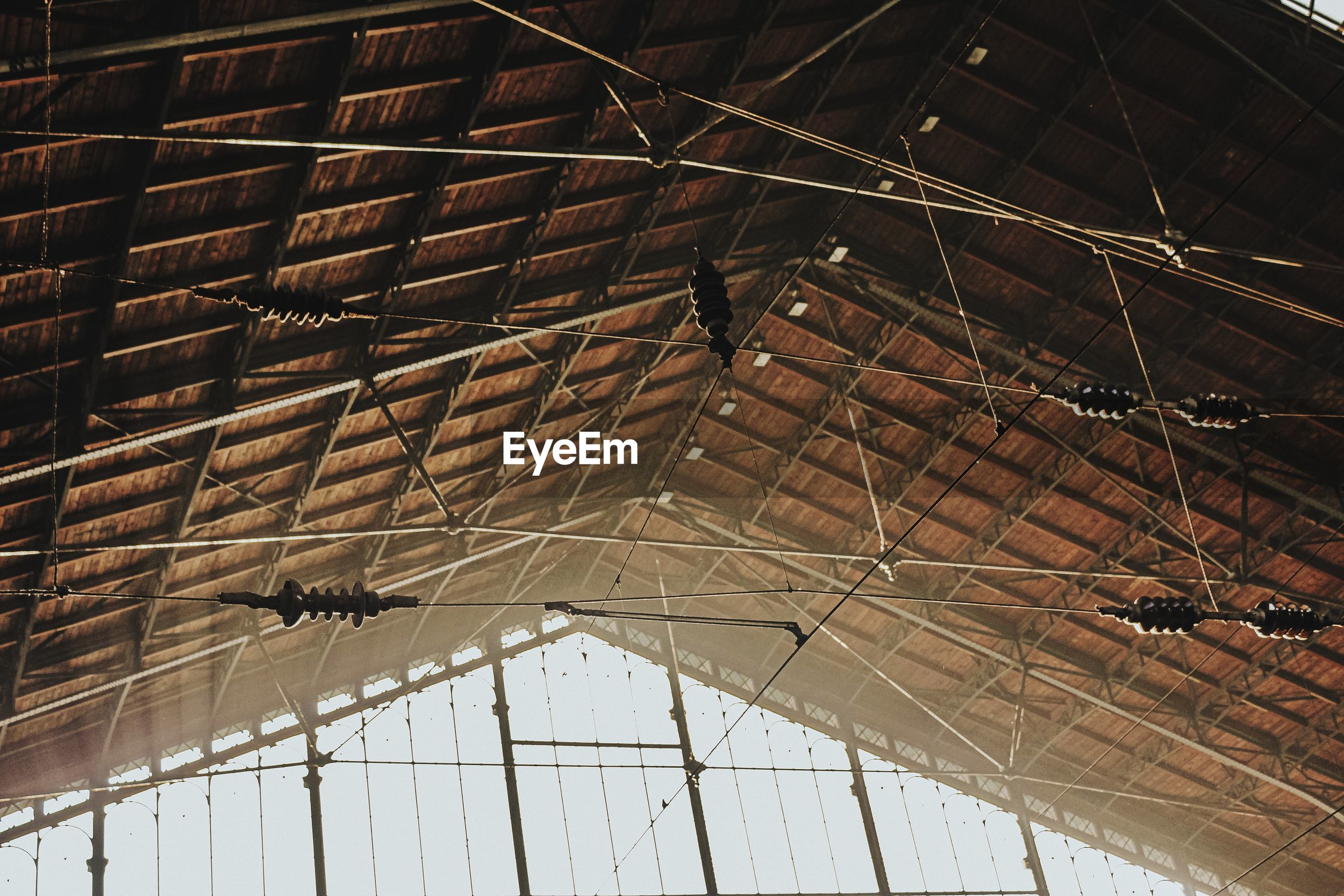 Low angle view of train station roof hanging from ceiling