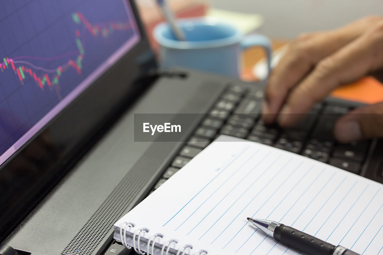 human hand, hand, technology, human body part, computer, one person, real people, human finger, finger, selective focus, wireless technology, computer equipment, laptop, working, indoors, occupation, connection, communication, table, using laptop, keyboard