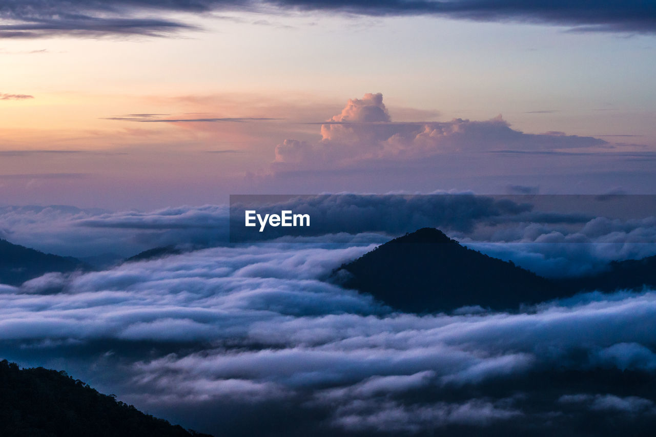 Scenic View Of Mountain Peaks During Sunset