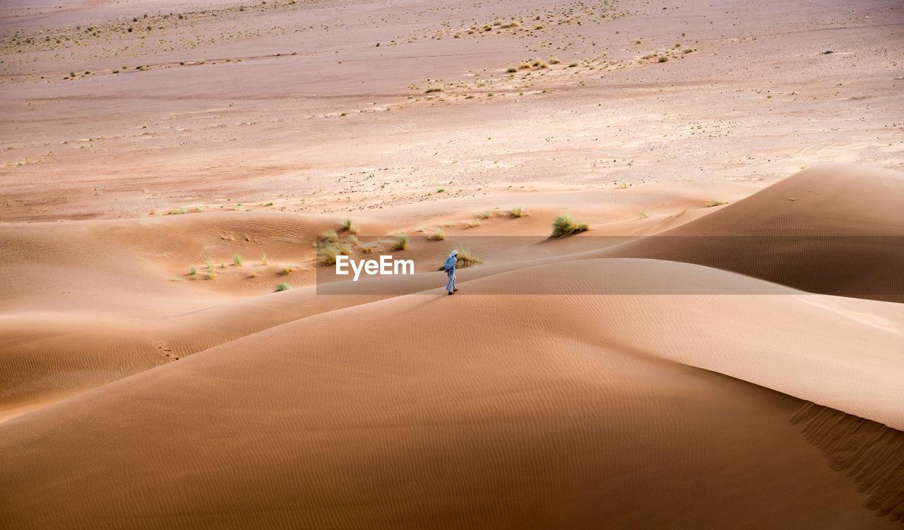 Full Length Of Person On Sand Dune In Desert