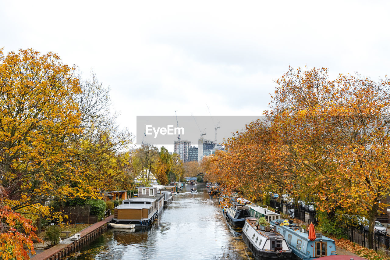 autumn, plant, tree, architecture, change, nature, built structure, sky, day, water, building exterior, transportation, mode of transportation, no people, orange color, growth, city, nautical vessel, river, outdoors, autumn collection
