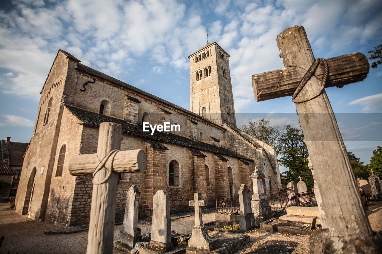 sky, religion, architecture, spirituality, belief, built structure, cloud - sky, history, the past, place of worship, nature, low angle view, building exterior, cross, old, no people, day, building, architectural column, ancient civilization, ruined