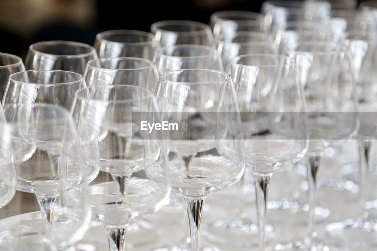 Close-up of empty wineglasses on table