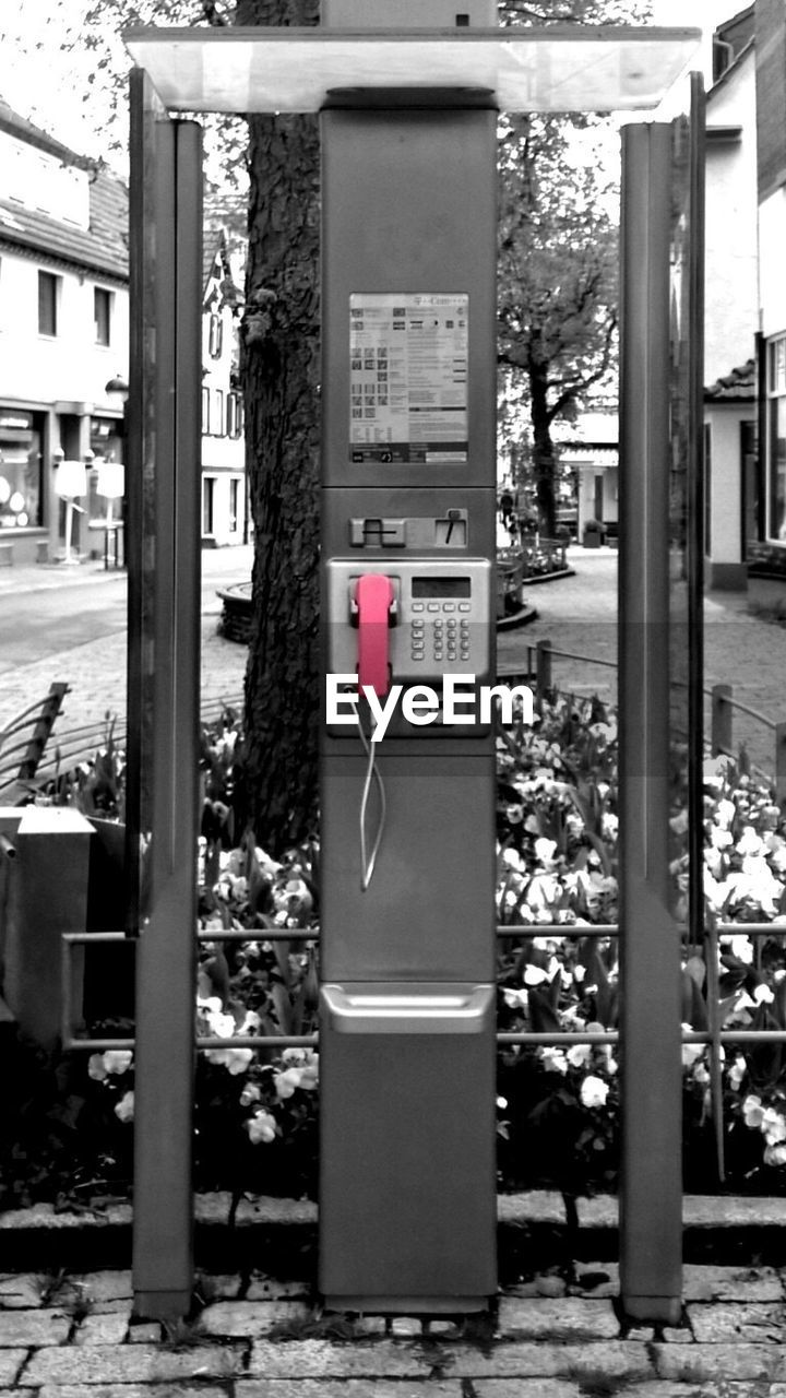 Pink Pay Phone On Sidewalk In City
