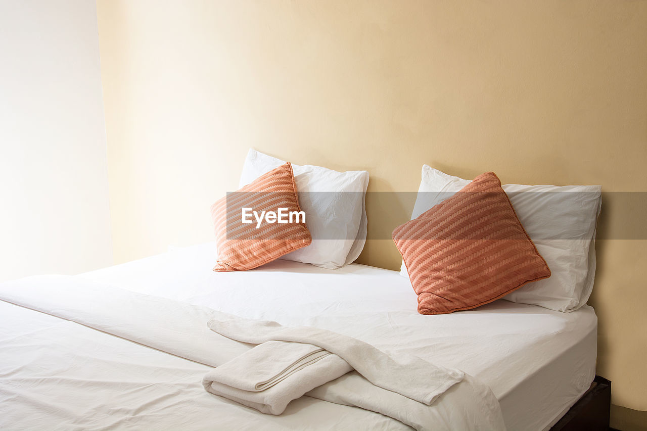 Pillows And Cushions On Bed At Home