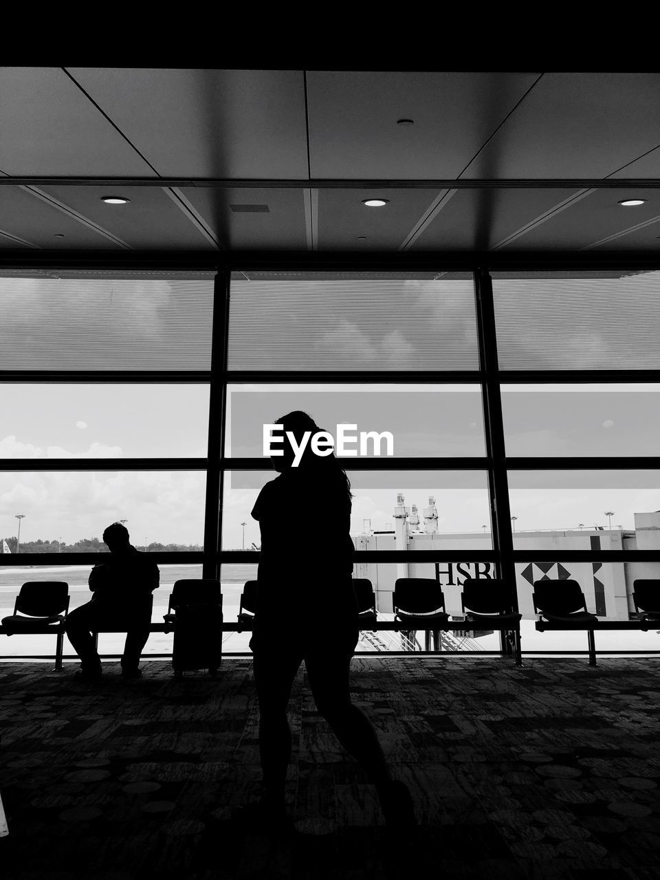 Silhouette People At Airport Waiting Room